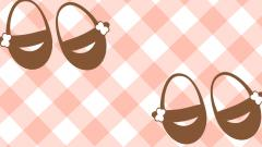 Baby Booties For A Girl On Checkered Background