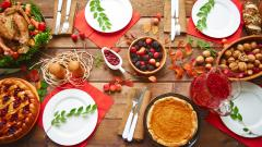 Thanksgiving table with various delicious food dishes.